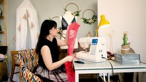 Woman tailor sews lace sexy lingerie in a sewing studio
