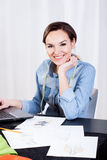 Woman tailor sitting in front of computer Royalty Free Stock Photo