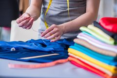 Woman tailor working on a clothing sewing stitching measuring fa Royalty Free Stock Photo