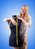 Woman tailor working on dress Stock Photos