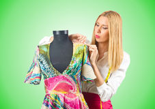 Woman tailor working on dress Royalty Free Stock Photography
