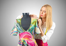 Woman tailor working on dress Royalty Free Stock Image