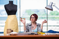 The woman tailor working at her desk Royalty Free Stock Photos