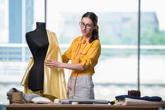 The woman tailor working on new clothing Stock Photo