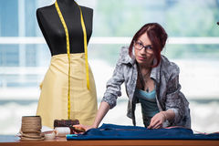 The woman tailor working on new clothing Royalty Free Stock Images