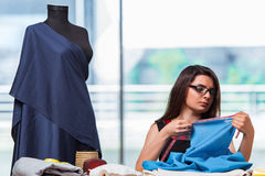 The woman tailor working on new clothing Royalty Free Stock Photos