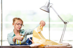 The woman tailor working on new clothing Stock Photography