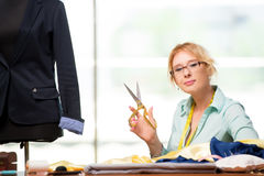 The woman tailor working on new clothing Royalty Free Stock Image