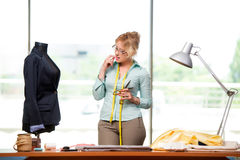 The woman tailor working on new clothing Royalty Free Stock Photography