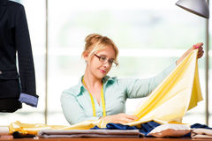 The woman tailor working on new clothing Stock Photos