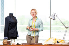 The woman tailor working on new clothing Royalty Free Stock Photo