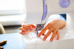 Woman tailor working on sewing machine. Hands. close up. Tailori Stock Images