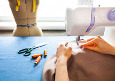 Woman tailor working on sewing machine. Hands. close up. Tailoring. Details. Close up royalty free stock photography