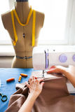 Woman tailor working on sewing machine. Hands. close up. Tailoring. Details. Close up royalty free stock photos