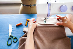 Woman tailor working on sewing machine. Hands. close up. Tailoring. Details. Close up stock photography
