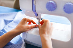 Woman tailor working on sewing machine. Hands. close up. Tailoring. Details. Close up royalty free stock images