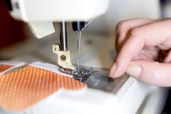 Woman tailor working on sewing machine stock images