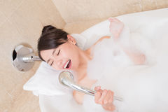 Woman take the bath. Beauty woman relax and take bath in the bathroom royalty free stock image
