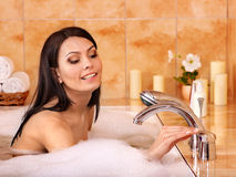 Woman take bubble  bath. Royalty Free Stock Photography