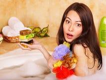 Woman take bubble  bath. Royalty Free Stock Images