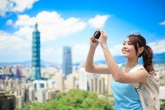 Woman take camera Royalty Free Stock Photography