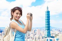 Woman take camera Stock Photography