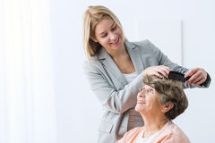 Woman take care of grandmother. Image of helpful women take care of ill grandmother Stock Images
