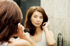 Woman take care of her beauty. Stock Images