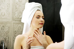Woman take care of her beauty. Royalty Free Stock Images