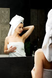 Woman take care of her beauty. Royalty Free Stock Image