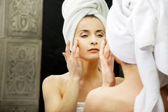 Woman take care of her face. Stock Photography