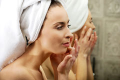 Woman take care of her face. Royalty Free Stock Image