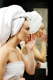 Woman take care of her face. Royalty Free Stock Photography