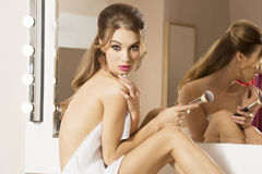 Woman take care of her near mirror Royalty Free Stock Images