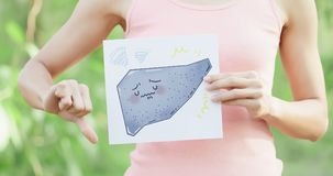 Woman with cirrhosis liver. Woman take cirrhosis liver billboard with green background royalty free stock photos