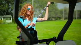 The woman take a club from the cart stock video footage