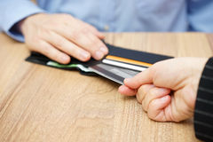 Woman take credit card from man Stock Photography