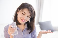 Woman with water and medicine stock photos