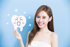 Woman take cute tooth Royalty Free Stock Photo
