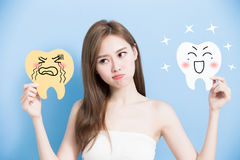 Woman take cute tooth Royalty Free Stock Image