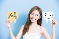 Woman take cute tooth Royalty Free Stock Photos