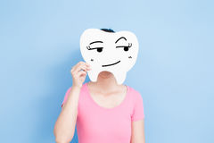 Woman take cute tooth. Woman take cute look something tooth on the blue background Stock Photos