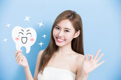 Woman take cute tooth Stock Photos