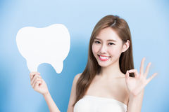Woman take cute tooth Royalty Free Stock Photography