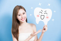 Woman take cute tooth Stock Image