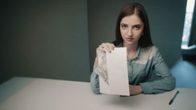 Woman take five hundred cash money from envelope on grey background. Officer got bribe. stock footage