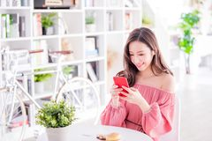 Woman take a food photo. By smart phone in a restaurant royalty free stock images