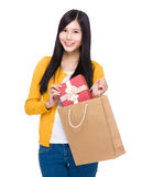 Woman take gift box from shopping bag Royalty Free Stock Photo