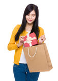 Woman take giftbox from shopping bag Royalty Free Stock Photography