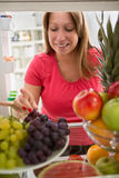 Woman take grain of grapes and tasting it Stock Photo